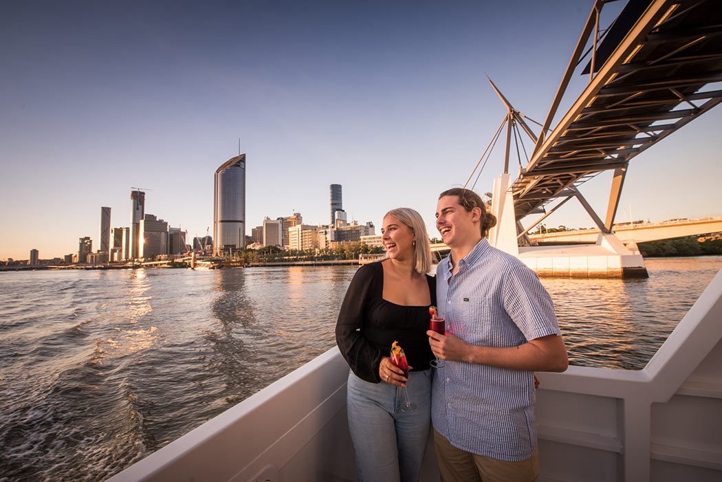 Couple laughing Brisbane twilight cruise with Mirimar Cruises