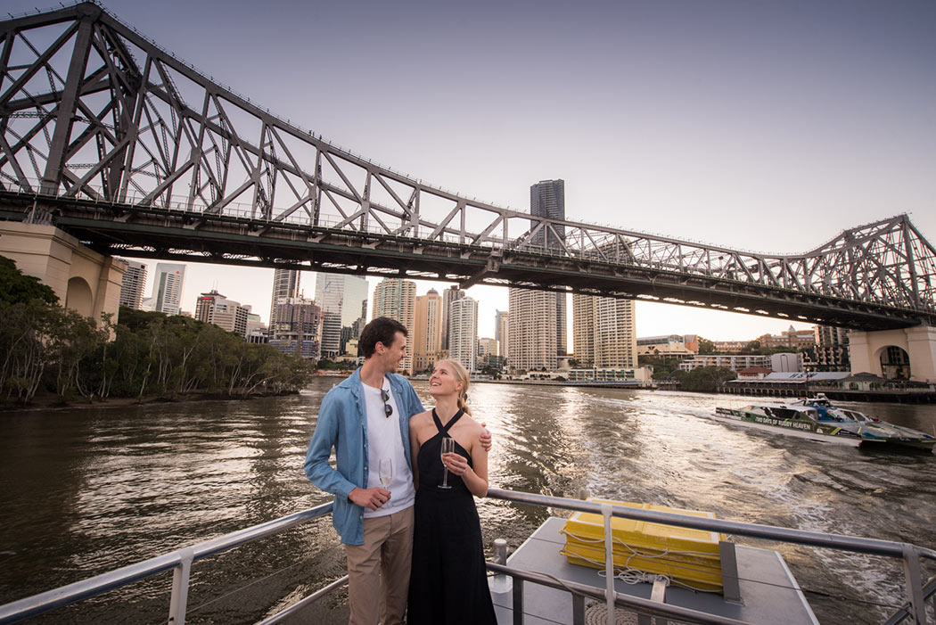 Couple having a beautiful moment Brisbane twilight cruise with Mirimar Cruises
