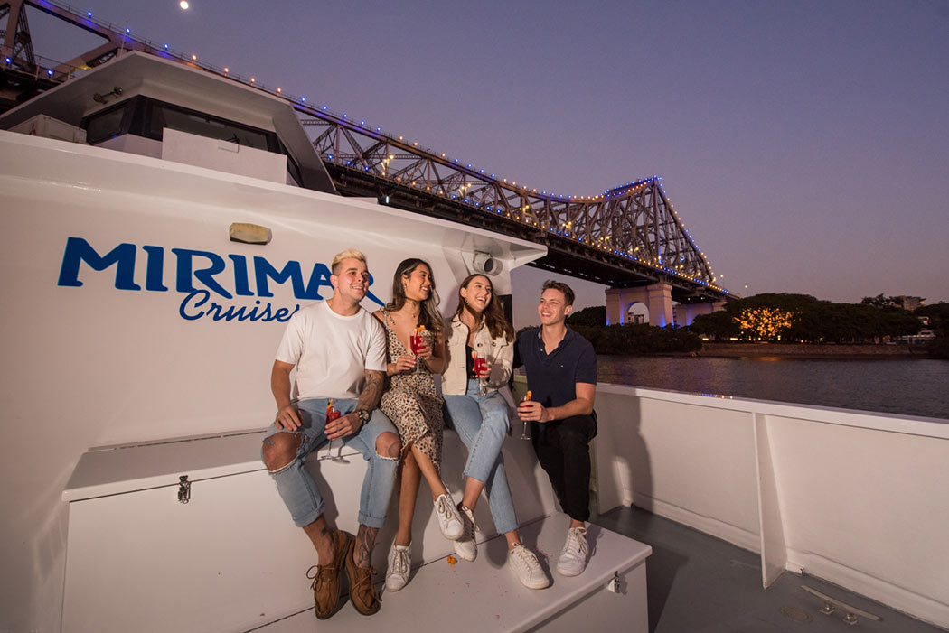 Friends enjoying drinks Brisbane twilight cruise with Mirimar Cruises